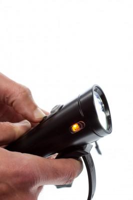 Knopf zur Steuerung der seitlichen Lampen