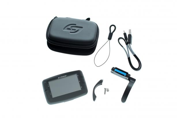 Im Lieferumfang finden sich jedenfalls neben dem Dash ein USB-Kabel, eine kleine Kordel (wofür auch immer), eine praktische Aufbewahrungsbox sowie die Lenkerhalterung.